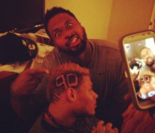 Darnell-Dockett-Tyrann-Mathieu-haircut-hazing